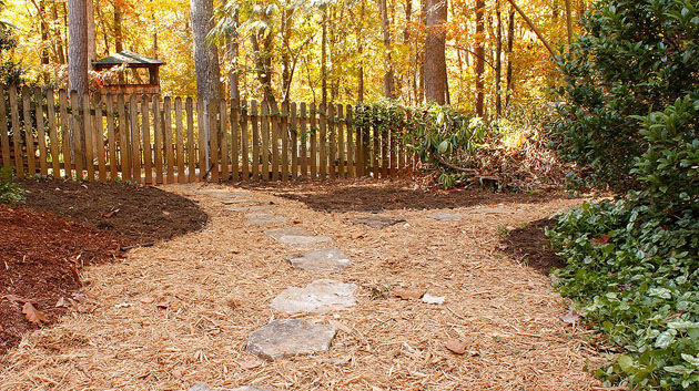 landscaped backyard with mulch pathway