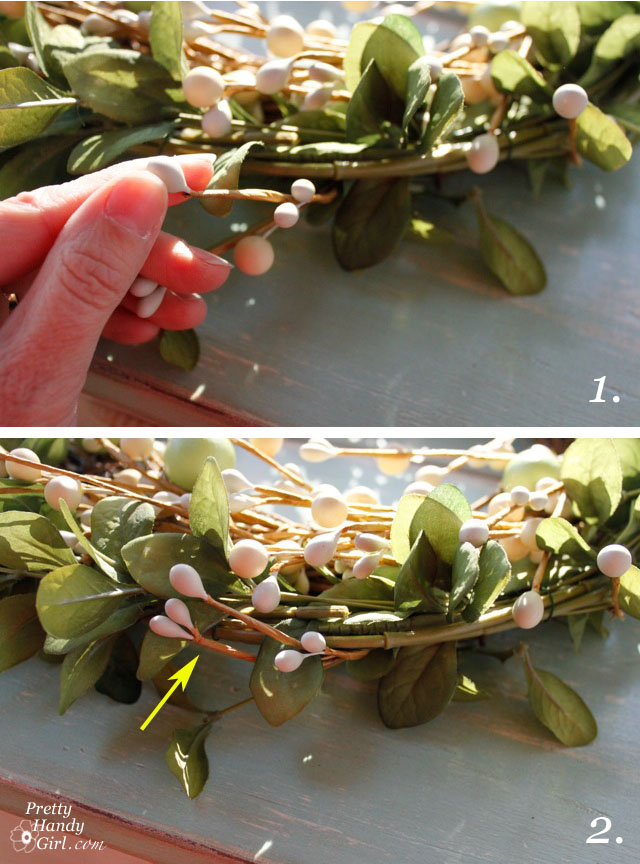 wrap berry stems around leaf wreath