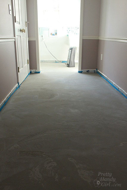 How to patch and level a concrete subfloor pretty handy girl let the leveling liquid dry overnight before walking on it the self leveling liquid will dry lighter and to a matte finish solutioingenieria Image collections
