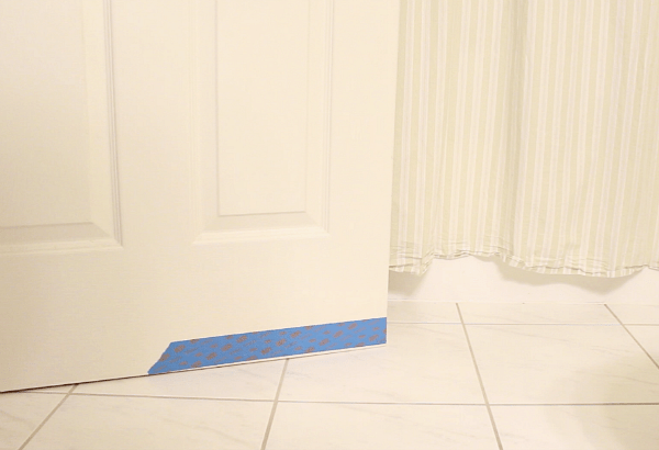 Place tape on door bottom