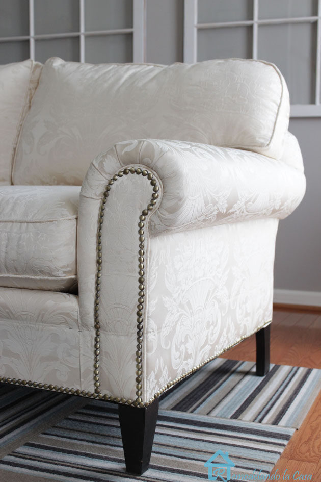 nailhead trim on arm of sofa