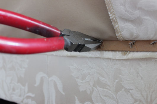 pulling out staples from sofa skirt
