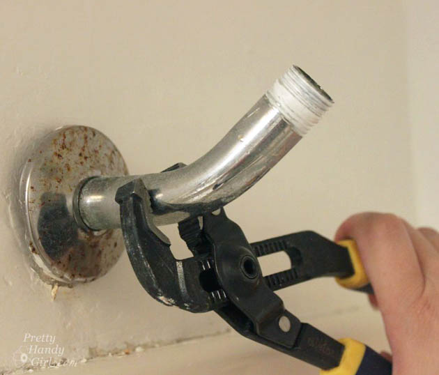 unscreEasy! How to Install a New Showerhead | Pretty Handy Girlw-old-shower-arm