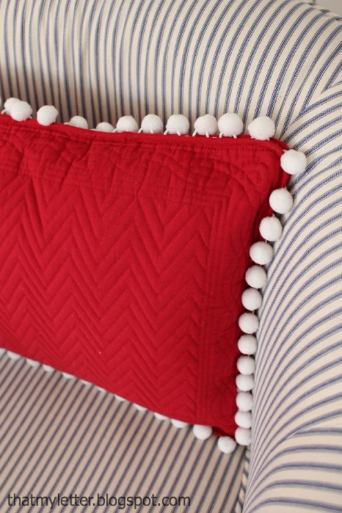 diy pom pom pillow from placemat