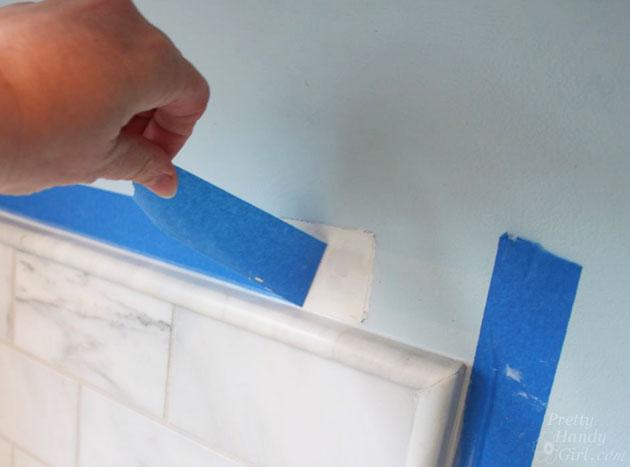 remove-painters-tape-caulk-backsplash