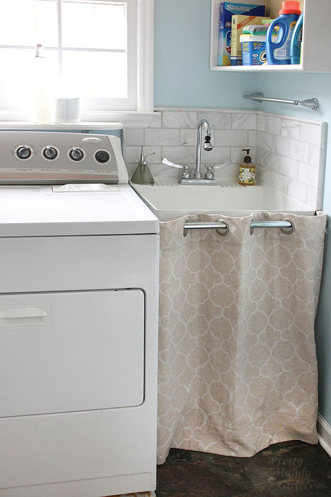 easy sewing projects to help you learn to sew - hidden storage under laundry sink hem curtain