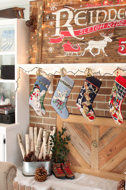 stockings-hung-rustic-wood-fireplace