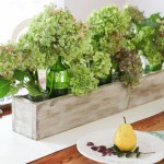 Green and purple hydrangeas in rustic wood trough. Build Your own Rustic Trough Centerpiece tutorial.