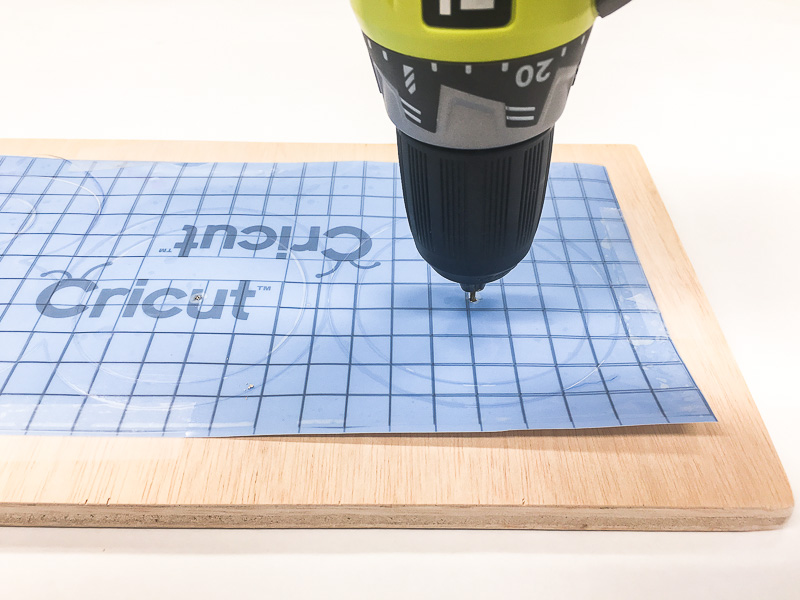 Drill a hole to mark the center of the O's on your Halloween sign.
