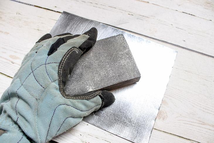 2. Sand Sheet metal edges and base.
