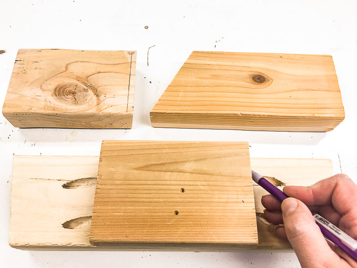 Cut all your scrap wood pieces the same size to make these stocking holders.