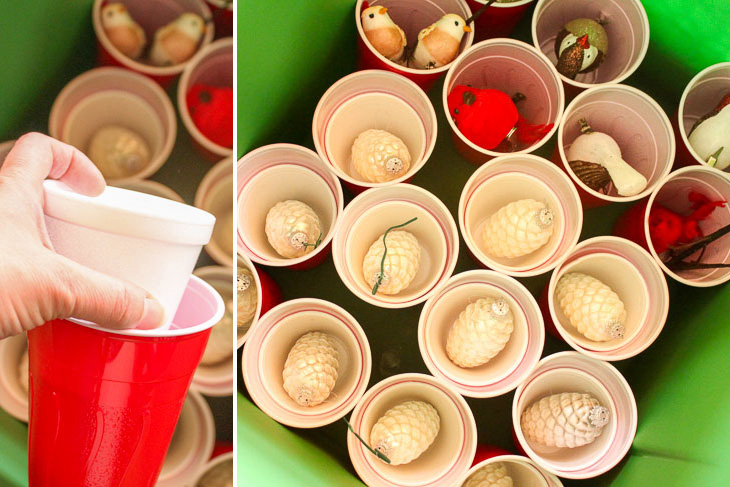 put ornaments in foam and plastic cups