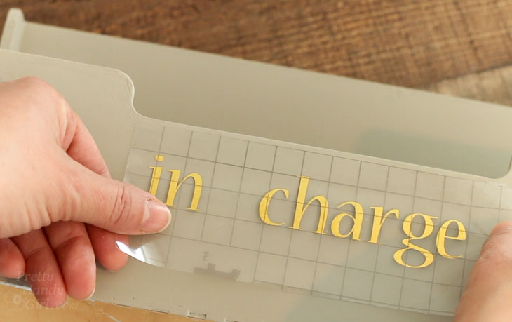 """Add vinyl lettering """"in charge"""""""
