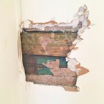 bead board peeking through drywall hole