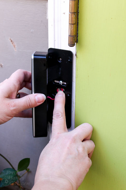 gently-tuck-wires-into-house Wiring A Doorbell on wiring light, wiring multiple doorbells, household wiring doorbell, repair a doorbell, 2 bells wiring for doorbell, wiring ceiling fan, wiring switch, wiring smoke detectors,