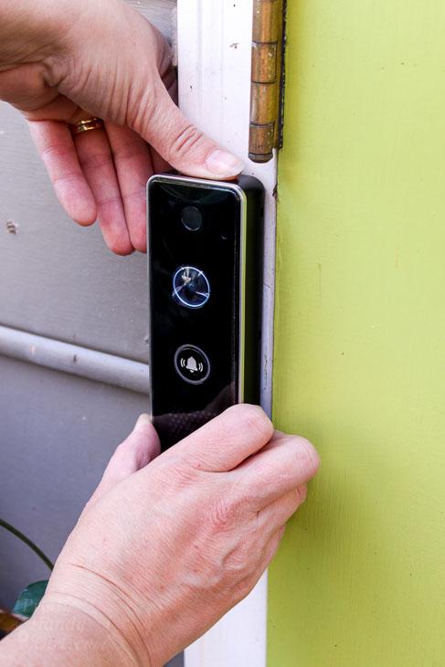 Set video doorbell into mounting bracket