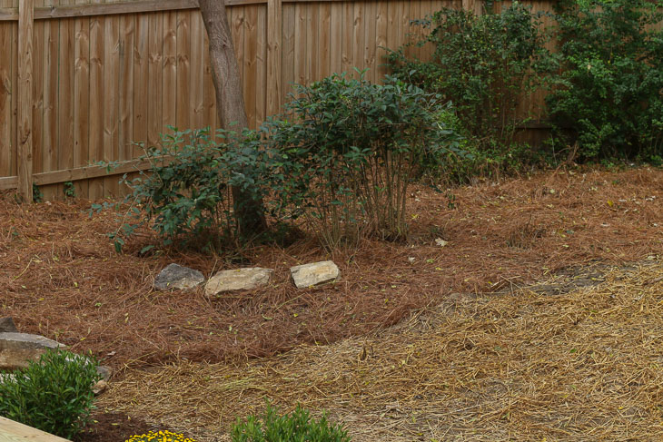 three pier stones from original house used as landscaping rocks