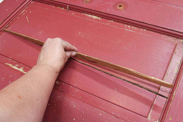 Insert wood spline into door crack