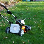 man pushing lawnmower shown from back