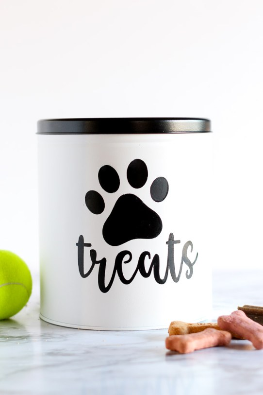 Love this idea for using an old popcorn tin from the holidays as a customizable DIY dog treat container!