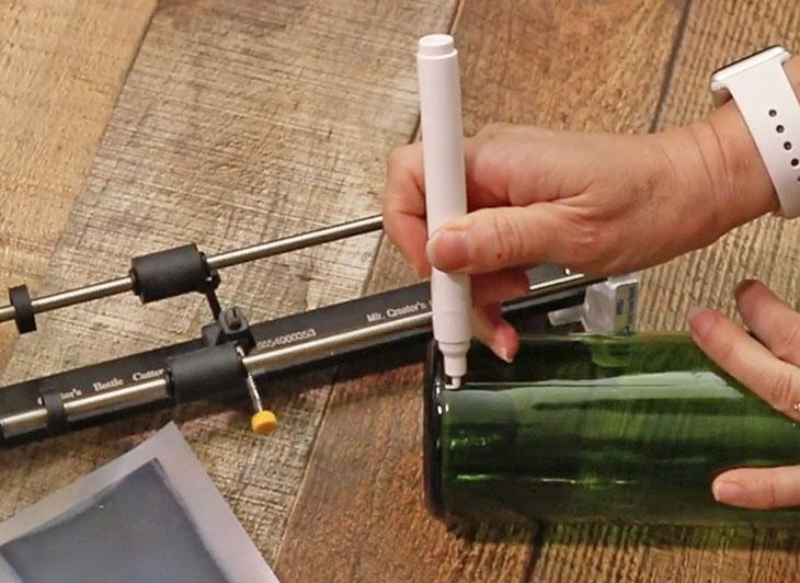 mark bottom of wine bottle with white paint pen