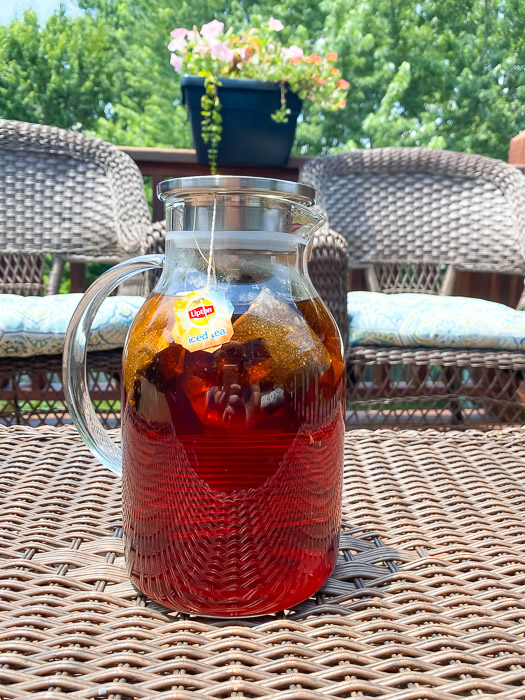 Sun tea brewing outside in a glass pitcher