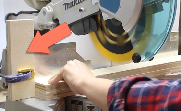 stop block clamped to miter saw fence