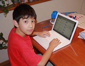 boy-using-computer-1306380-640x498