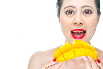 fashion woman eating mango, health, beauty, makeup, model, happy, bite