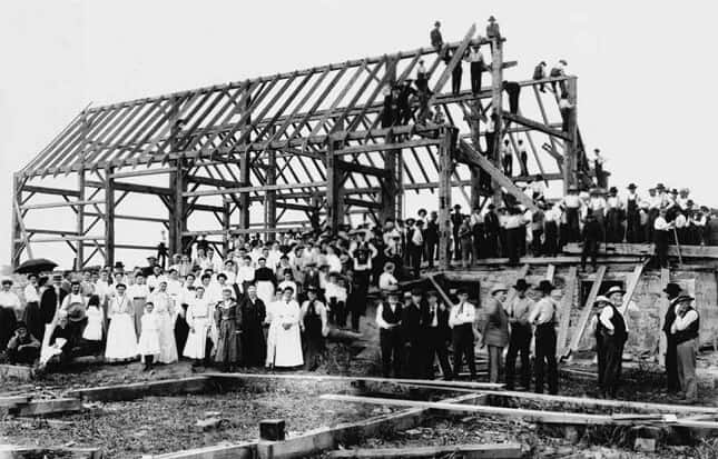People building house