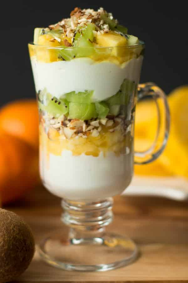 Kiwi Pineapple Parfait layered in a glass cup