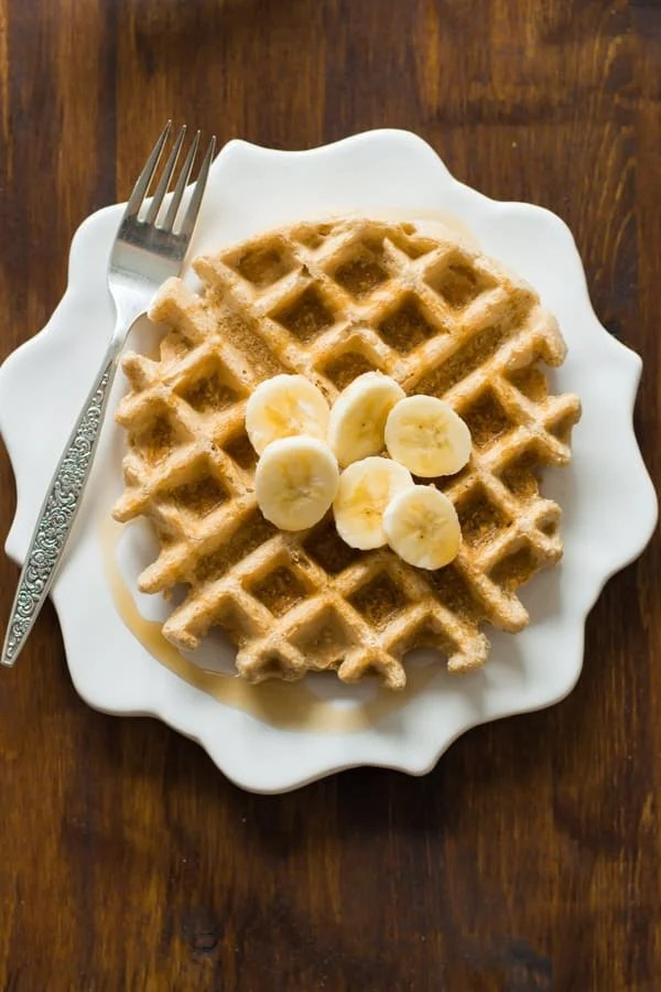 waffles made with peanut butter with sliced bananas on top