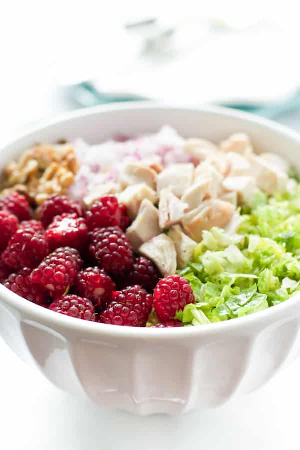 close up of Chopped Salad with Tayberries in a white bowl