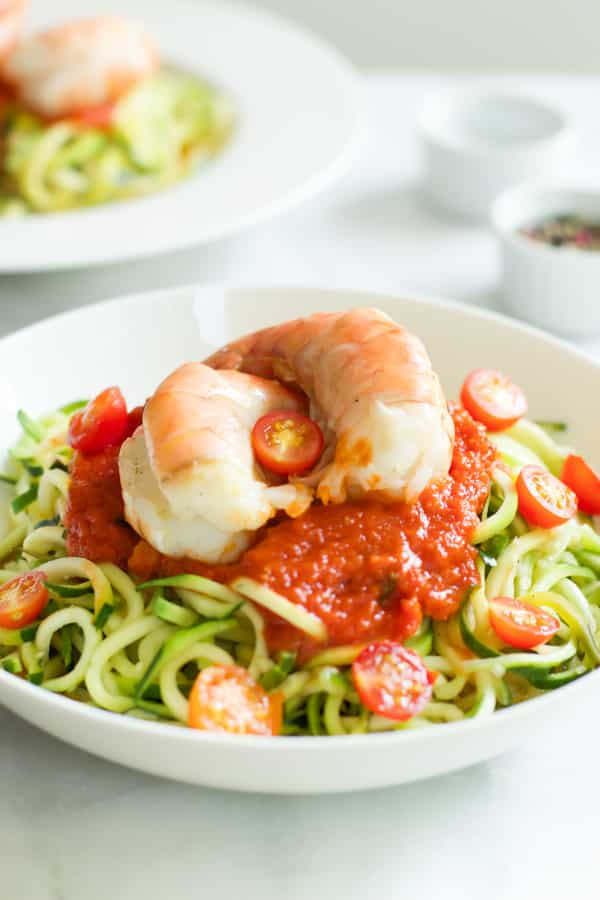 Zucchini noodles with tomato sauce and shrimp.