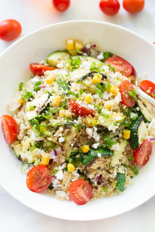 Close up on Zucchini Couscous Salad in a white bowl