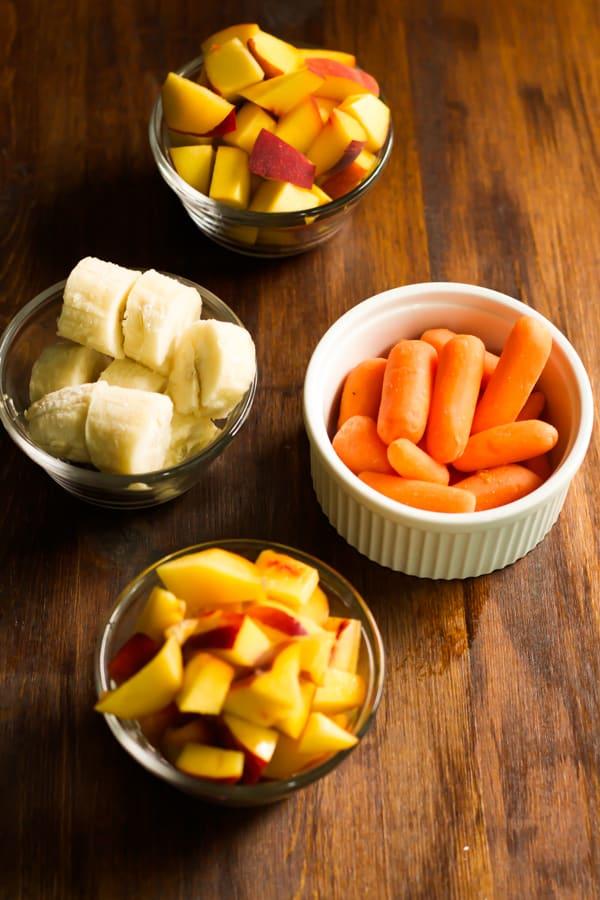 Peach Carrot Smoothie ingredients in prep bowls.