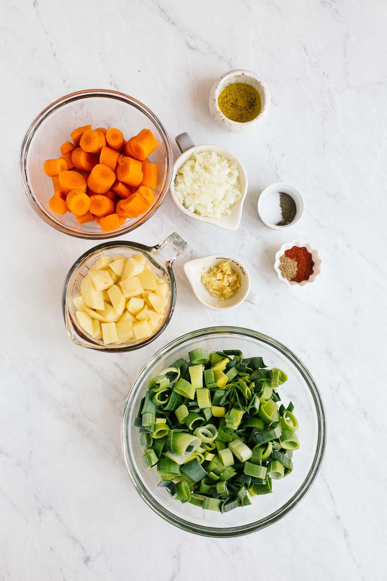 Overhead image of ingredients needed to make carrot leek soup.