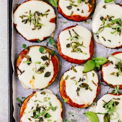 overhead view of eggplant pizza on a baking sheet