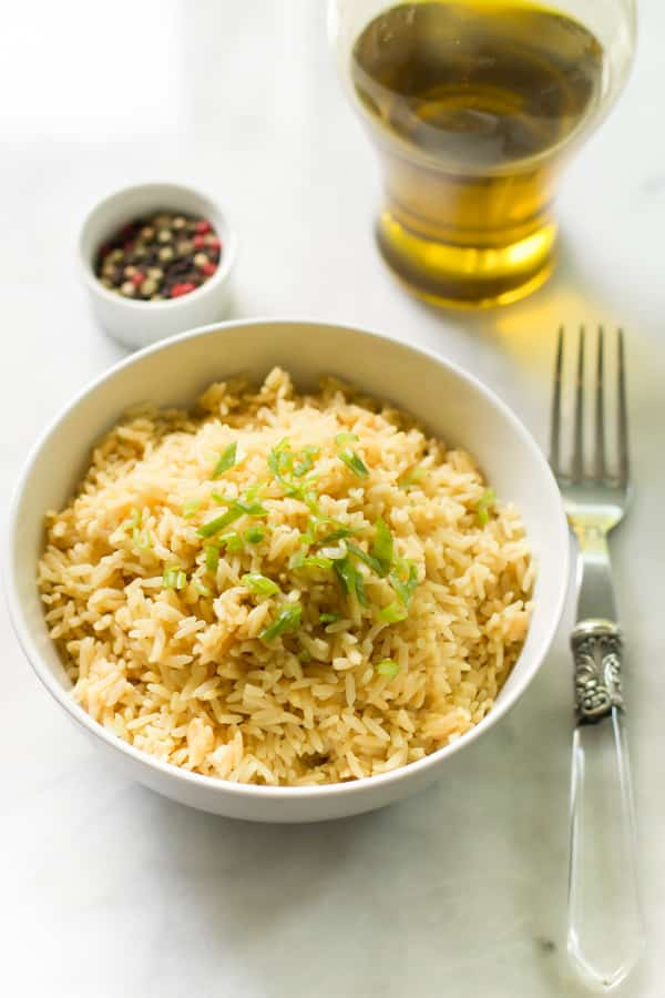fluffy rice in a bowl with a fork beside it
