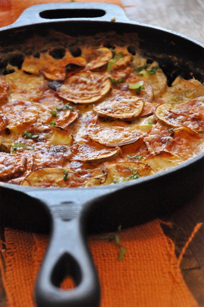 Sweet potato parmesan gratin in a cast iron skillet.