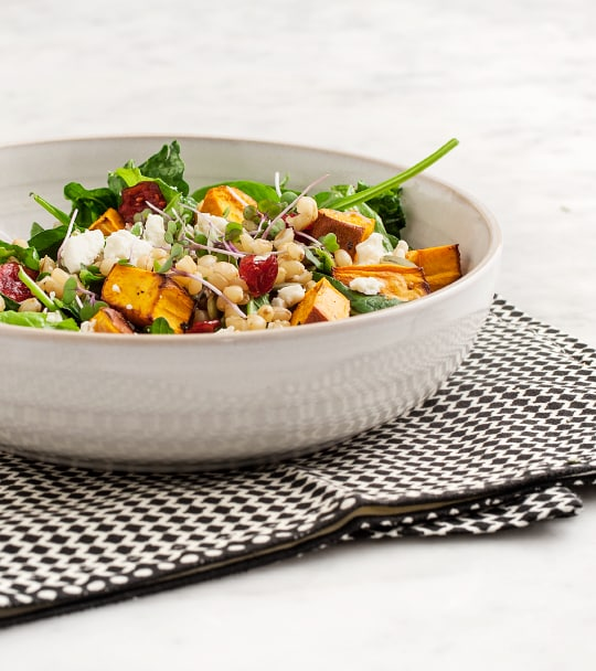 Roasted sweet potato and wheatberry salad in a bowl.