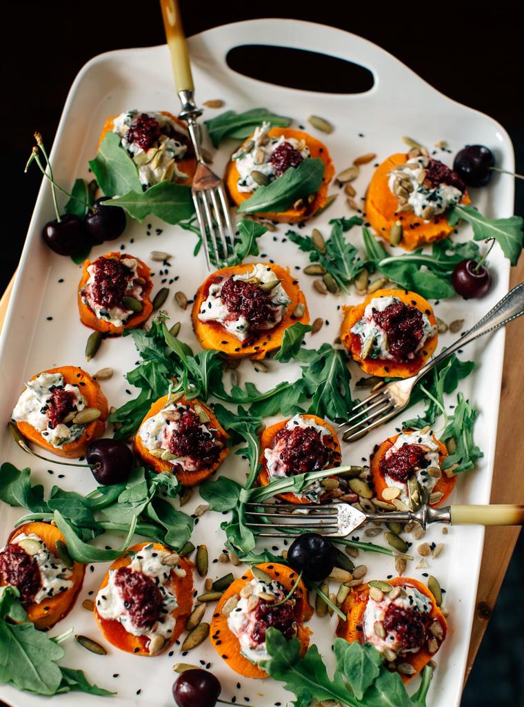 A white serving tray of sweet potato with smokey eggplant dip cherry chutney.