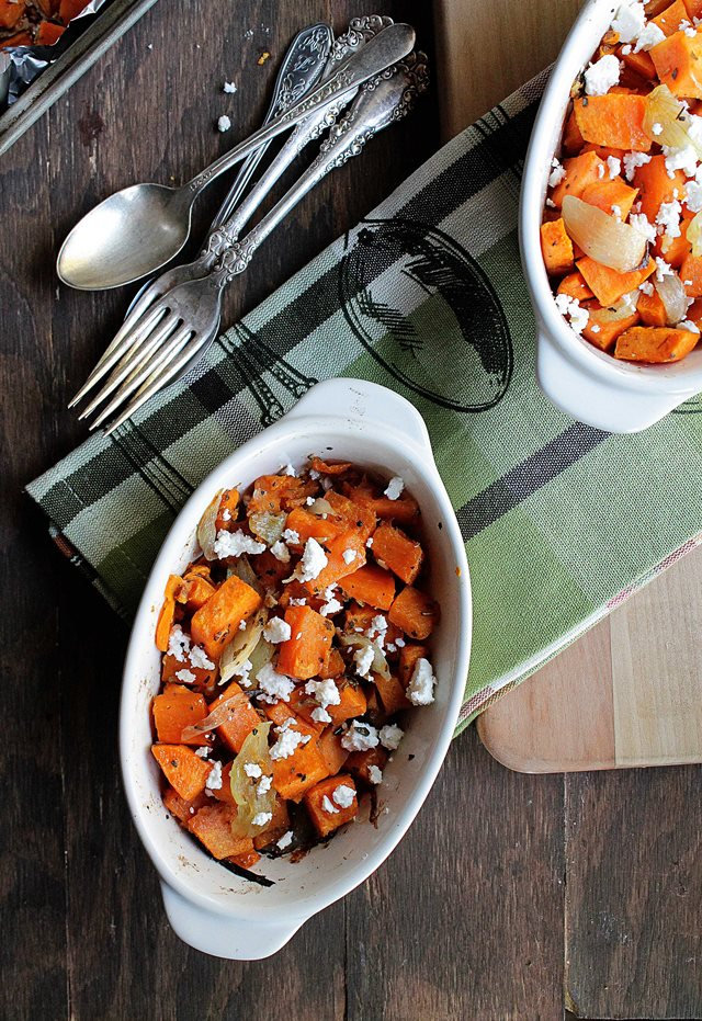 Two serving bowls of sweet potato hash with onions feta.