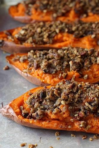 A close up of twice baked sweet potato yam on a sheet pan.