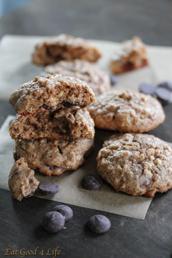 Stack of oatmeal almond butter chocolate chip cookies with chocolate chips scattered around.