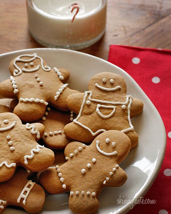 Gingerbread men on a white plate.