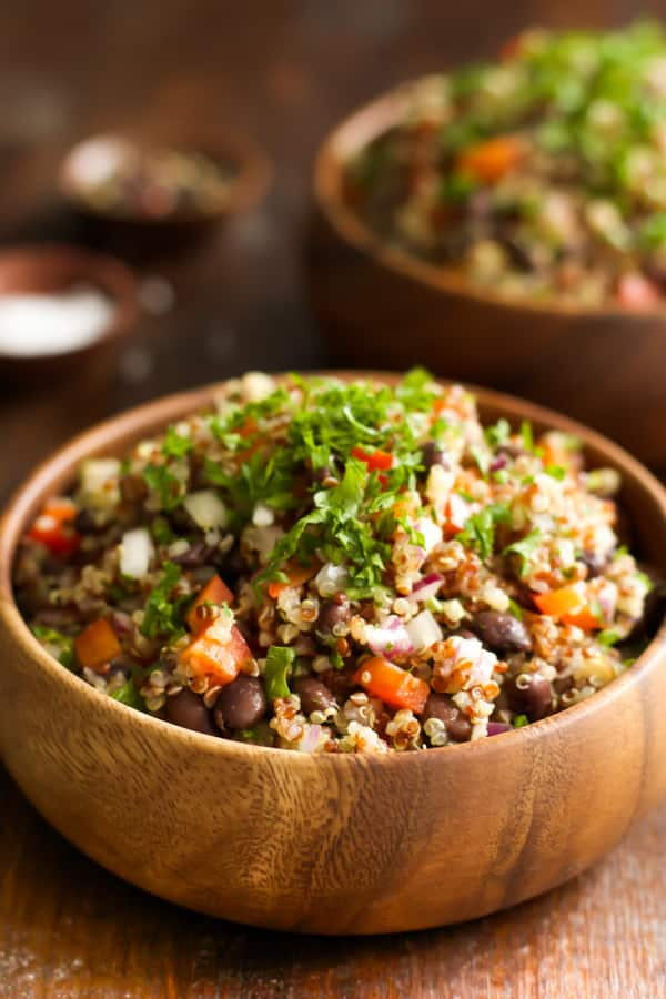 A wooden bowl of a quick and easy quinoa salad.