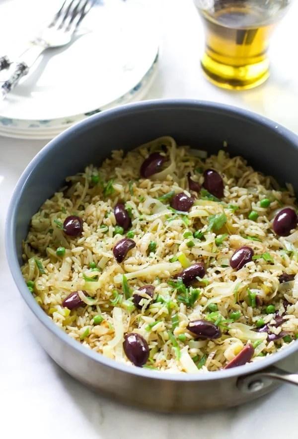 A bowl containing leek kalamata rice.