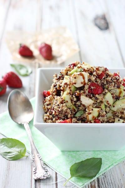 Strawberry quinoa balsamic salad in a white bowl.