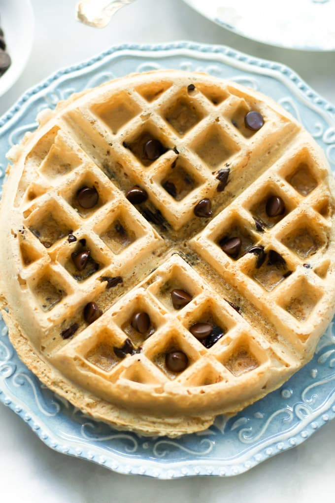 Close up of an almond butter waffle with chocolate chips.